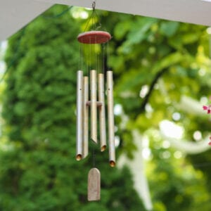 wind chimes hanging on a house